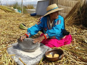 Woman on Uros Floating Islands on Lake Titicaca